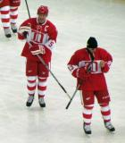 Nicklas Lidstrom and Vyacheslav Kozlov stand on the ice before the start of the second Alumni Showdown game.