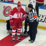 Mickey Redmond talks to an official before the start of the second Alumni Showdown game.