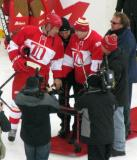 Viacheslav Fetisov helps lead Vladimir Konstantinov onto the ice before the start of the second Alumni Showdown game.