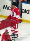 Vyacheslav Kozlov stands near the bench before the start of the second Alumni Showdown game.