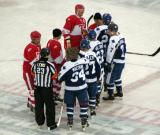 The starters for the Red Wings alumni and the Maple Leafs alumni shake hands at center ice before the start of the second Alumni Showdown game.