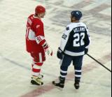 Sergei Fedorov and Tiger Williams talk before a faceoff in the second Alumni Showdown game.