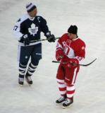 Wendel Clark and Vyacheslav Kozlov skate during a stoppage in the second Alumni Showdown game.