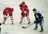 Doug Brown, Paul Coffey and Lanny McDonald get set for a faceoff during the second Alumni Showdown game.