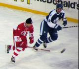Tomas Holmstrom and Bryan McCabe shadow each other down the ice during the second Alumni Showdown game.