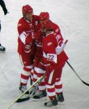 Brendan Shanahan, Steve Yzerman and Dino Ciccarelli laugh together during the second Alumni Showdown game.