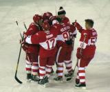 Paul Coffey, Doug Brown, Darren McCarty, Tomas Holmstrom and Larry Murphy mob Manny Legace after the Red Wings alumni defeat the Maple Leafs alumni in a shootout in the second Alumni Showdown game.