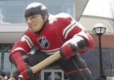 An inflatable hockey player is part of the Spectator Plaza decor outside Michigan Stadium for the Winter Classic.