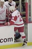 Chris Chelios steps onto the Detroit bench during a stoppage of play.