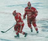 Darren Helm and Justin Abdelkader skate in the neutral zone during pre-game warmups before a snowy Winter Classic.