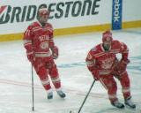 Daniel Cleary and Darren Helm skate in the neutral zone during pre-game warmups before a snowy Winter Classic.