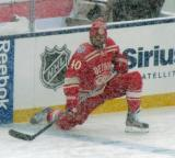 Henrik Zetterberg crouches at the blue line during pre-game warmups before a snowy Winter Classic.
