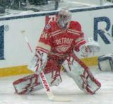 Petr Mrazek stretches along the boards during pre-game warmups before a snowy Winter Classic.