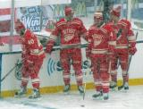 Henrik Zetterberg, Brian Lashoff, Jakub Kindl and Luke Glendening stand along the boards during pre-game warmups before a snowy Winter Classic.