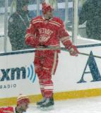 Brian Lashoff skates along the boards during pre-game warmups before a snowy Winter Classic.