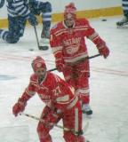 Kyle Quincey and Daniel Alfredsson skate during pre-game warmups before a snowy Winter Classic.