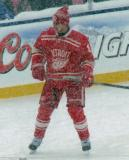 Justin Abdelkader stands near the boards during pre-game warmups before a snowy Winter Classic.