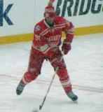 Mikael Samuelsson skates at center ice during pre-game warmups before a snowy Winter Classic.