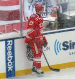 Tomas Tatar stands along the boards during pre-game warmups before a snowy Winter Classic.