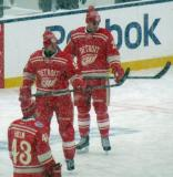 Niklas Kronwall and Brian Lashoff check out their sticks during pre-game warmups before a snowy Winter Classic.