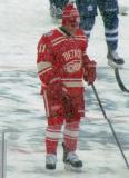 Daniel Alfredsson stands at center ice during pre-game warmups before a snowy Winter Classic.