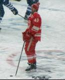 Darren Helm stands at center ice during pre-game warmups before a snowy Winter Classic.