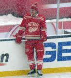 Brendan Smith stands along the boards during pre-game warmups before a snowy Winter Classic.