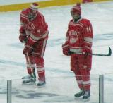 Jakub Kindl and Gustav Nyquist stand inside the blue line during pre-game warmups before a snowy Winter Classic.