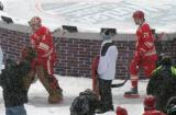 Jimmy Howard and Daniel Cleary lead the Red Wings out from the dressing room tunnel at the start of a snowy Winter Classic.