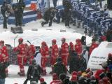 The Detroit Red Wings and Toronto Maple Leafs walk from the dressing room tunnel to the rink at the start of a snowy Winter Classic.