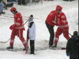Drew Miller and Henrik Zetterberg walk from the dressing room tunnel to the rink at the start of a snowy Winter Classic.