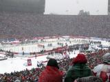 The Red Wings and Maple Leafs stand at attention for the singing of the national anthems prior to the start of a snowy Winter Classic.