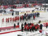 The Red Wings and Maple Leafs line up for a postgame handshake after a snowy Winter Classic.