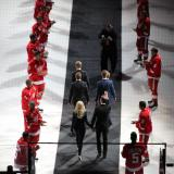 Nicklas Lidstrom and his family enter his jersey retirement ceremony, down a carpet flanked by Red Wings players wearing his #5 jersey.