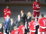 Nicklas Lidstrom and his family make their way into his jersey retirement ceremony, flanked by Red Wings players wearing his #5 jersey.