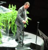 Ken Holland steps down from the podium after speaking at Nicklas Lidstrom's jersey retirement ceremony.