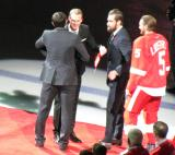 Pavel Datsyuk and Nicklas Lidstrom hug as Datsyuk, Henrik Zetterberg and Niklas Kronwall present Lidstrom with a team gift during Lidstrom's jersey retirement ceremony.