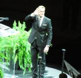 Nicklas Lidstrom waves to the crowd after taking the podium to speak at his jersey retirement ceremony.