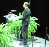 Nicklas Lidstrom stands at the lectern at his jersey retirement ceremony.