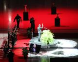 Nicklas Lidstrom waves to the crowd from the lectern during his jersey retirement ceremony.