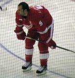 David Legwand crouches during pre-game warmups, wearing Nicklas Lidstrom's jersey in honor of its retirement.