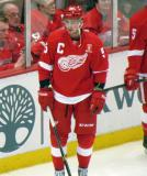 Tomas Jurco stands at the boards during pre-game warmups, wearing Nicklas Lidstrom's jersey in honor of its retirement.