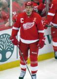 Jonathan Ericsson stands at the boards during pre-game warmups, wearing Nicklas Lidstrom's jersey in honor of its retirement.