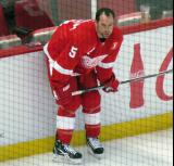 David Legwand crouches along the boards during pre-game warmups, wearing Nicklas Lidstrom's jersey in honor of its retirement.