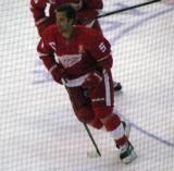 Kyle Quincey skates in the neutral zone during pre-game warmups, wearing Nicklas Lidstrom's jersey in honor of its retirement.