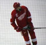 Drew Miller skates during pre-game warmups, wearing Nicklas Lidstrom's jersey in honor of its retirement.