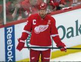 Johan Franzen stands near the boards during pre-game warmups, wearing Nicklas Lidstrom's jersey in honor of its retirement.