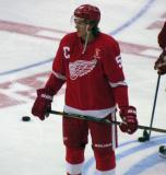 Danny DeKeyser stands in the neutral zone during pre-game warmups, wearing Nicklas Lidstrom's jersey in honor of its retirement.