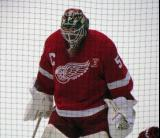 Jonas Gustavsson skates during pre-game warmups, wearing Nicklas Lidstrom's jersey in honor of its retirement.