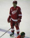 Teemu Pulkkinen stands at the blue line during pre-game warmups, wearing Nicklas Lidstrom's jersey in honor of its retirement.